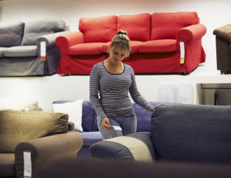 woman-looking-at-sofas-in-furniture-store.jpg