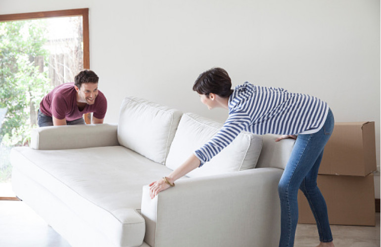 couple-moving-sofa-together-gettyimages.jpg