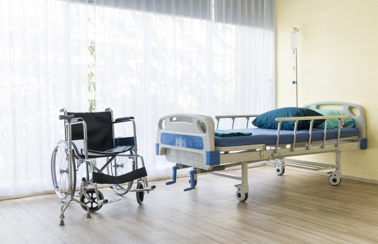 hospital-room-with-empty-bed-infusion-set-intravenous-fluid-wheelchairs.jpg