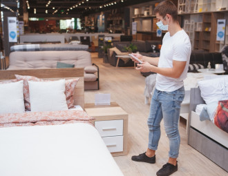 male-customer-wearing-medical-face-mask-shopping-furniture.jpg