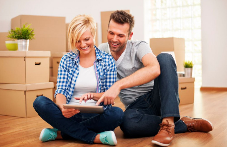 smiling-couple-buying-new-furniture-for-their-home.jpg