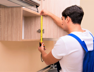young-man-assembling-kitchen-furniture.jpg
