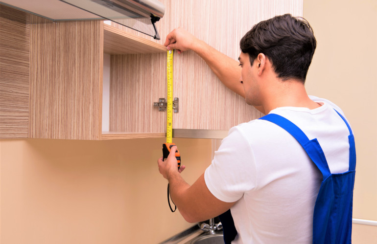 young-man-assembling-kitchen-furniture.jpg
