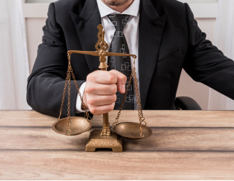 lawyer-with-weighing-scales.jpg