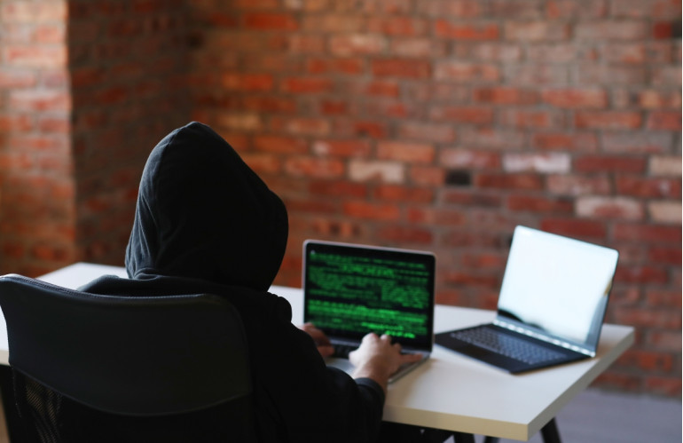 hacker-man-on-laptop.jpg
