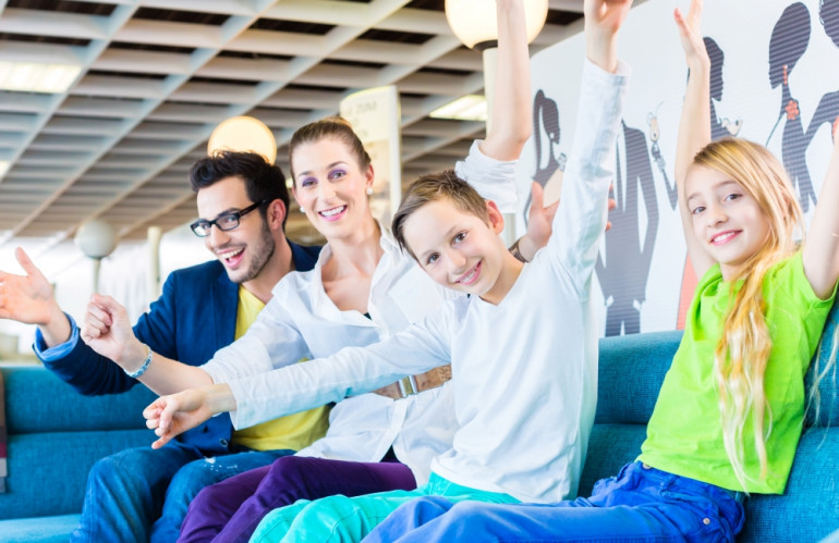 family-buying-couch-in-furniture-store.jpg