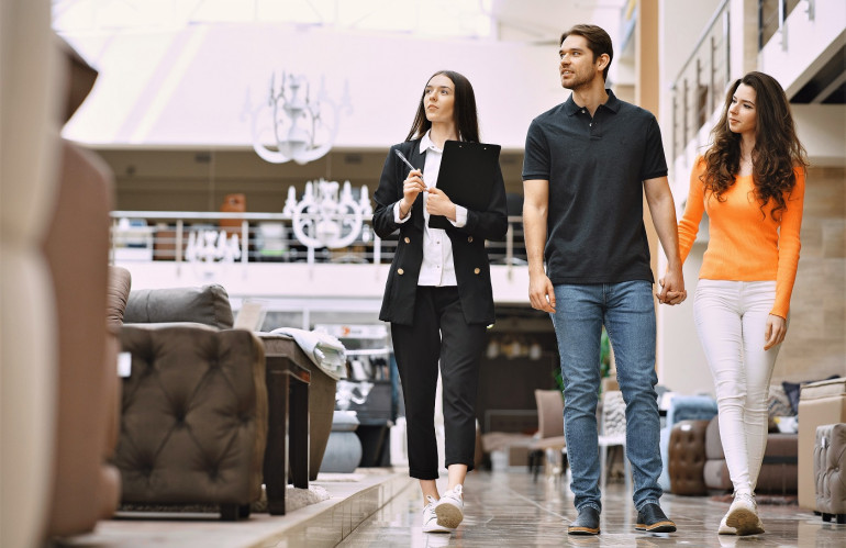 couple-with-salesman-in-furniture-store.jpg