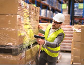 male-warehouse-worker-using-bar-code-scanner-analyze-storage-department.jpg