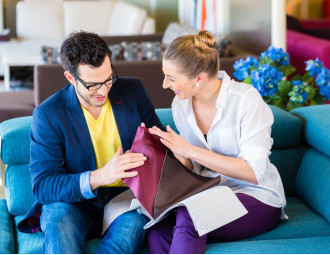young-couple-selecting-together-seat-cover-for-sofa-in-furniture-store.jpg
