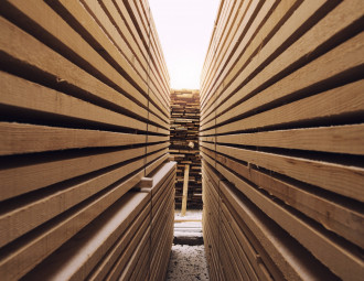 stack-of-wooden-planks-in-sawmill-lumber-yard.jpg